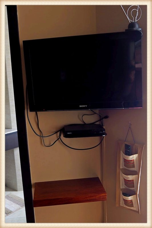 TV and DVD player. TV has HDMI cable and a custom shelf to place your laptop to attach to the cable.