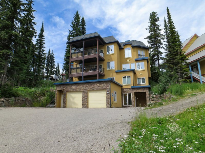 Front View from Monashee Road - Rare Flat Driveway.  Parking for 1 Car in Garage + Driveway Parking