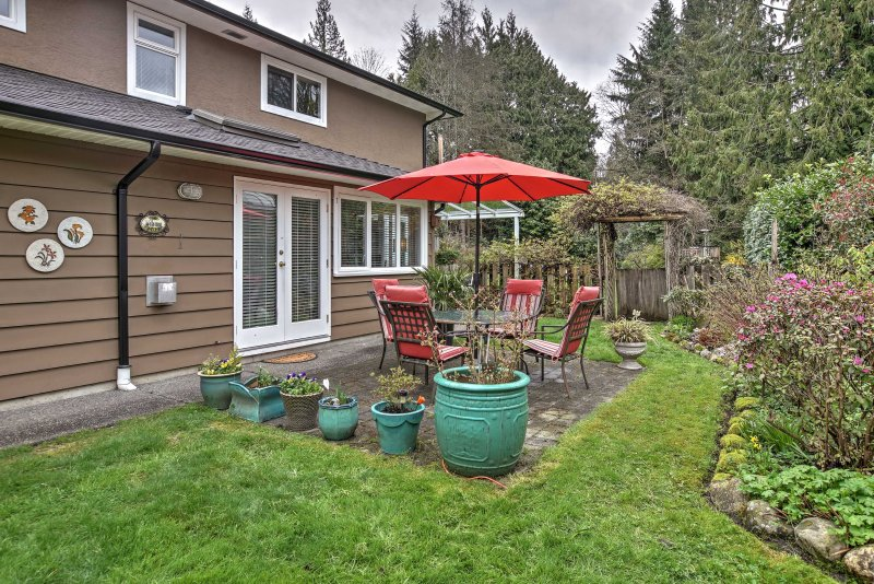 Enjoy this charming vacation rental home, complete with a spacious backyard.