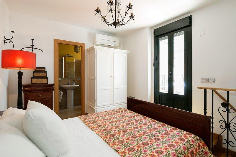 Bedroom. The door opens to the terrace.