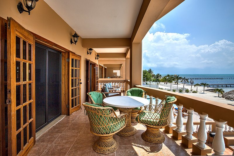 Spacious, oceanfront balcony with comfortable outdoor lounging and dining furniture!