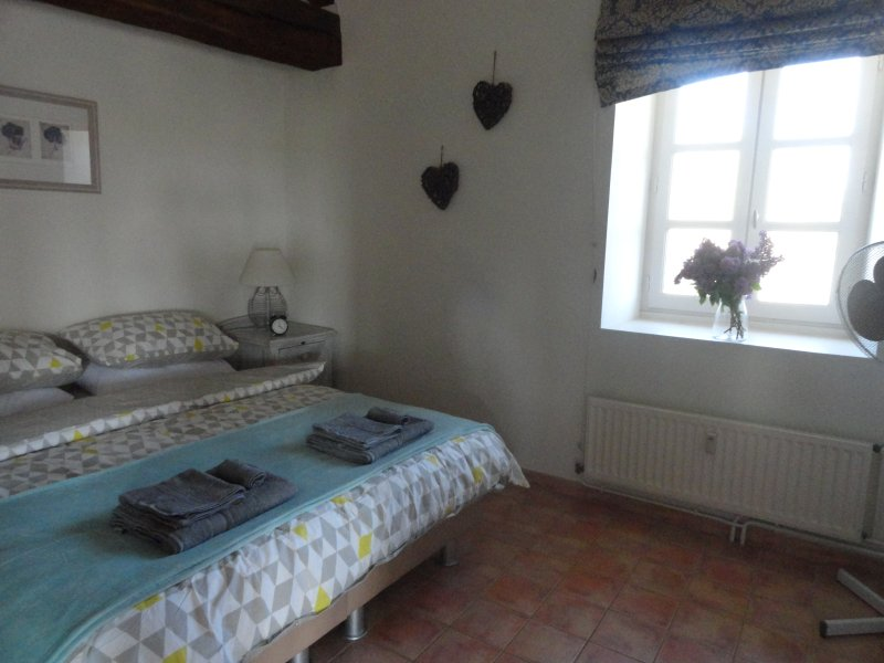 Double bedroom with twin wardrobes. Double bed can be split into 2 singles