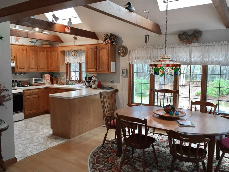Another view of dining area and look at kitchen