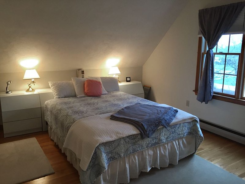 2nd floor bedroom with TV and queen bedh
