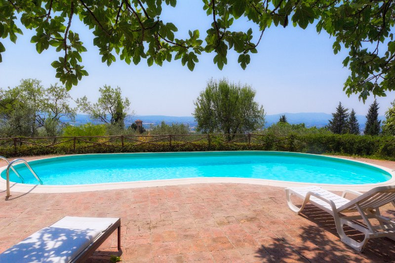 The pool with view at Villa Settimello, on the hills near Florence