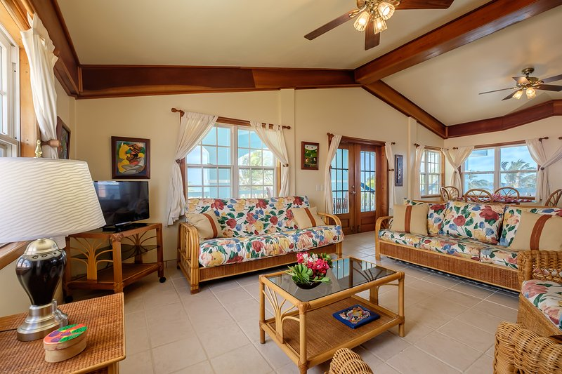 Beautiful light, airy living area. French doors lead to the balcony extending along the entire front