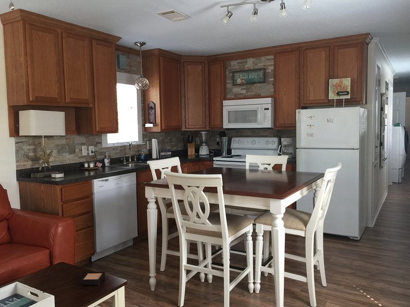 Fully equipped kitchen to cook all your meals and a hightop table to eat your dinners
