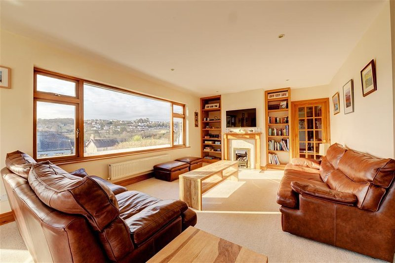 Sunny lounge with large picture window and lovely sea views.