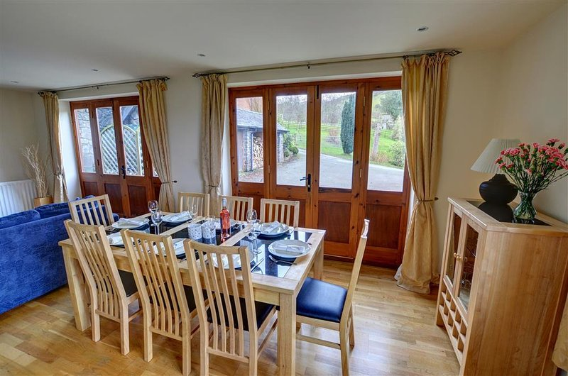 A lovely dining room to seat eight, with glazed doors to exterior