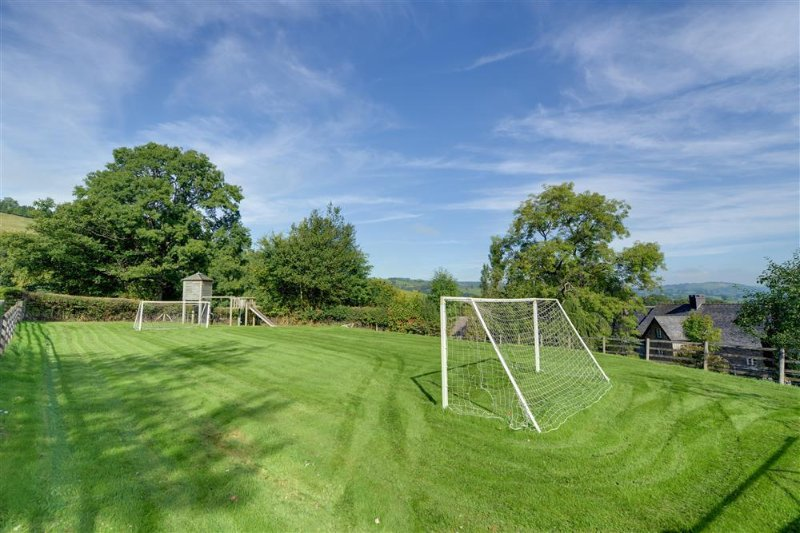 The grounds include shared play areas, for football and tennis