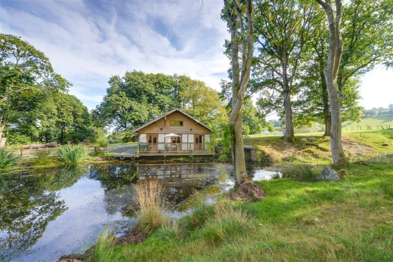 Derw Lodge is a detached wooden lodge standing in its own secluded location on the owners' extensive farmland