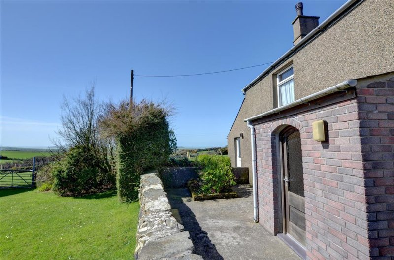Enjoy rural views to the coastline from the front and garden