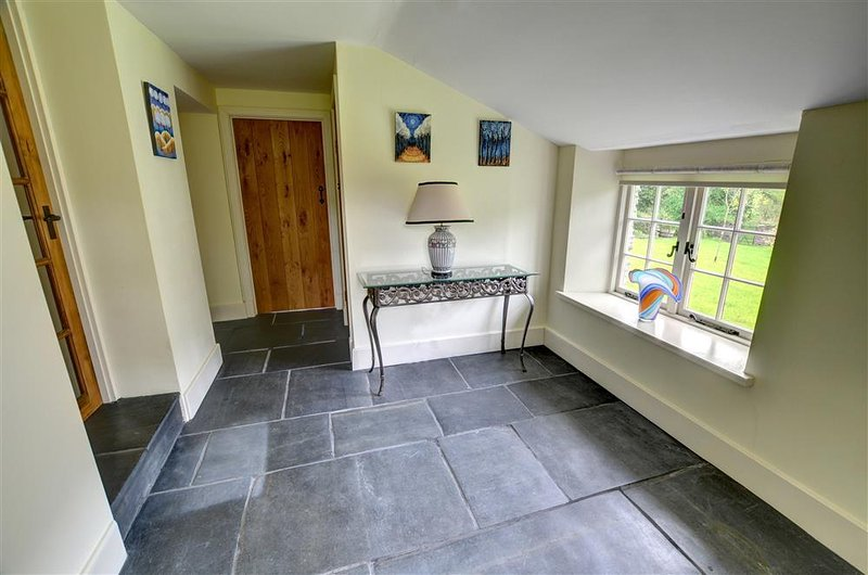 The spacious entrance hallway boasts a slate floor