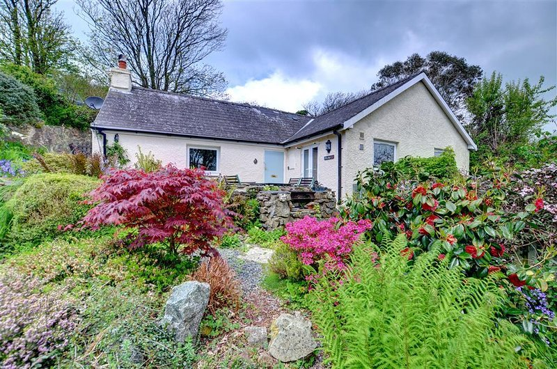This is a charming 200 year old detached cottage, set on a wooded hillside