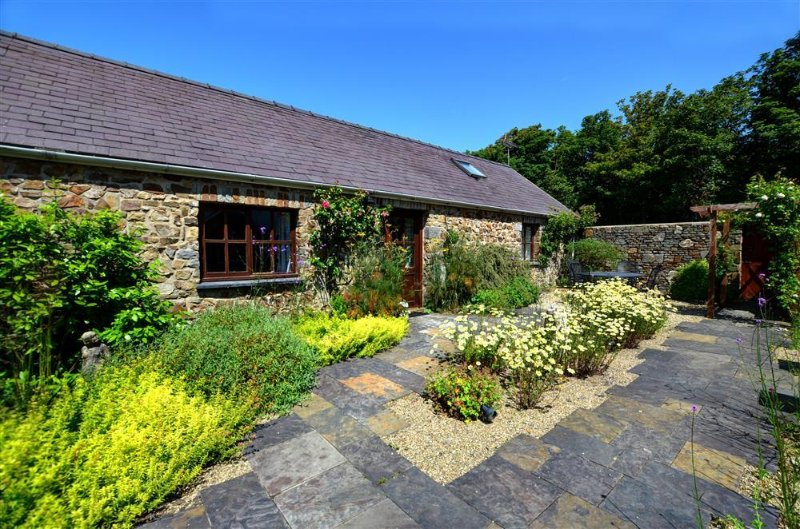 Rose Cottage is mostly a single-storey cottage converted from a stone farm building