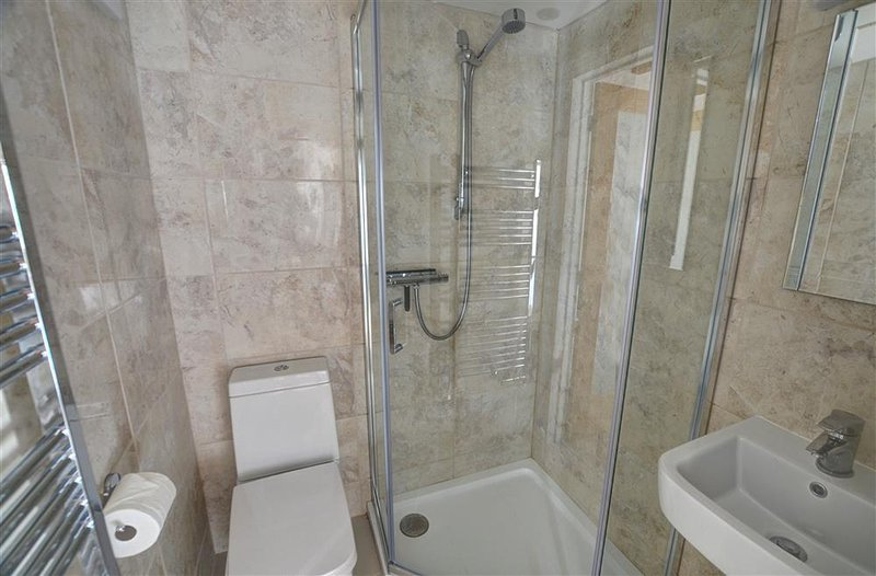 Small en suite bathroom with separate shower cubicle