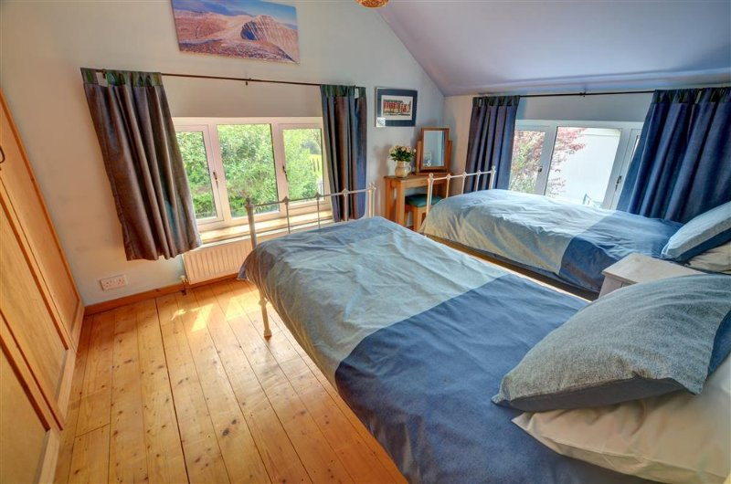 Smartly furnished twin bedroom with well-coordinated soft furnishings