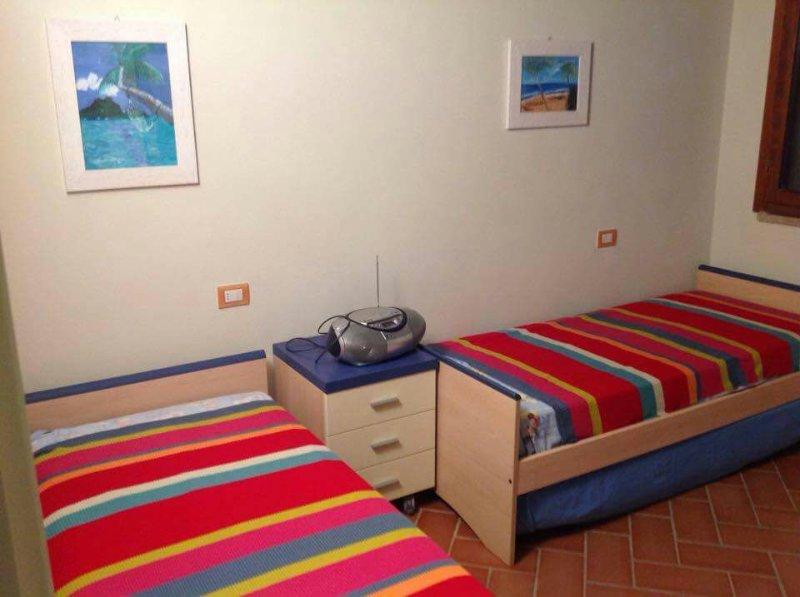 La bandita appartamento piano terra con giardino privato,patio 2 posti auto, location de vacances à Castiglione Della Pescaia