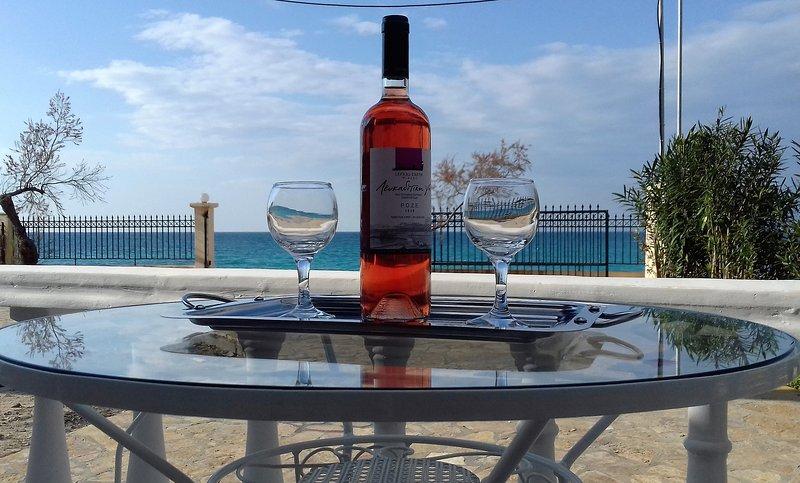 Ao mar varanda e relaxar com vinho local