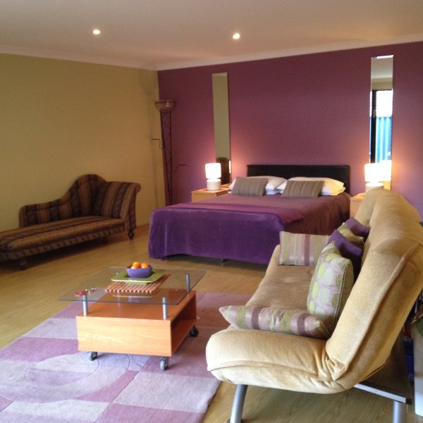 Rear studio with private courtyard. 1 Queen bed & sofa bed most suited for couples