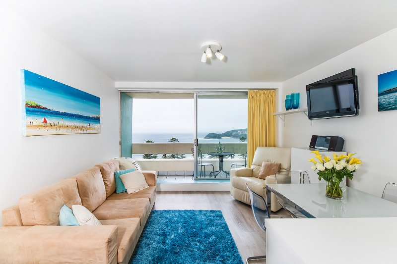 Comfortable living room with access to the balcony and beach views