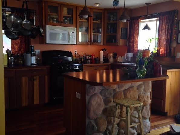 A cooks kitchen fully supplied including spices