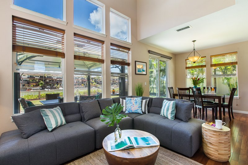 Your contemporary island hale awaits! As you enter you are greeted by a stylish and cozy living and dining room, with marina views.