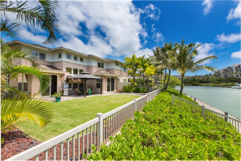 Walk out your back door to your tropical yard on the marina. Use your private gate to walk along the wall and explore.