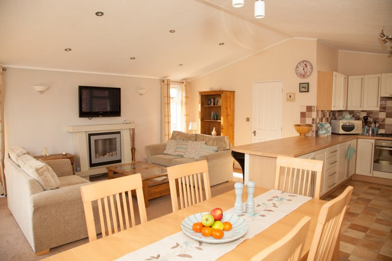 The spacious and comfortable interior of the South facing Daisy Lodge