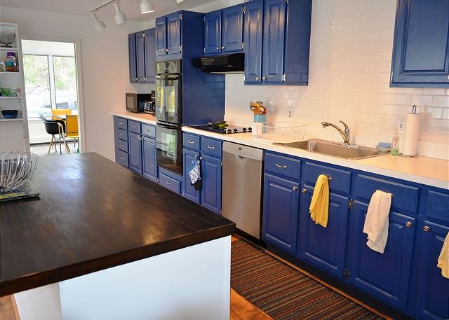 The large updated kitchen has a center island for easy meal prep