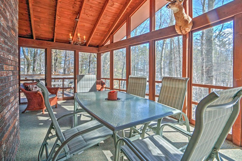 This screened-in porch is sure to be your favorite feature of this home!