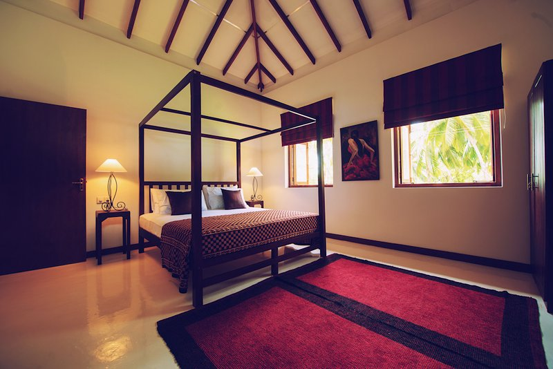 Deluxe Double King Bedroom over looking the sandy shore of Tangalle
