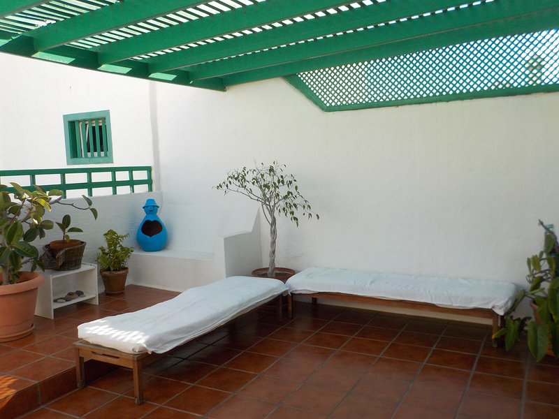 Part of the terrace with sunbeds