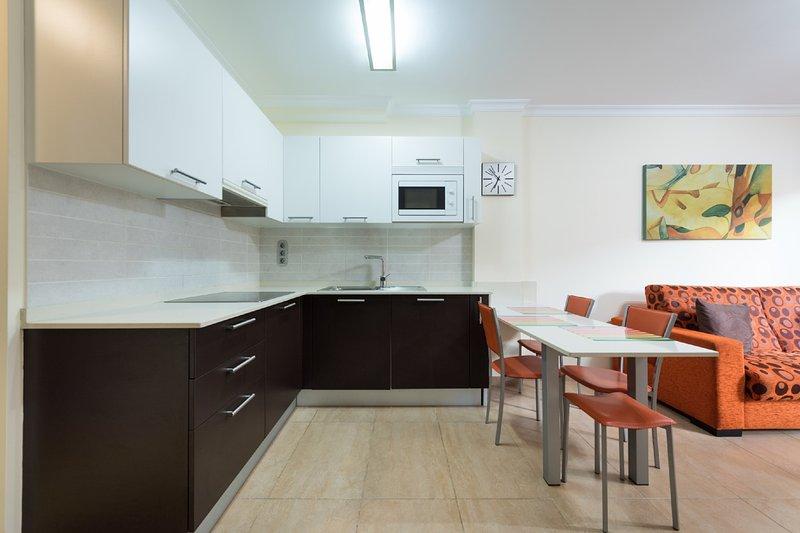 Kitchen with bar.