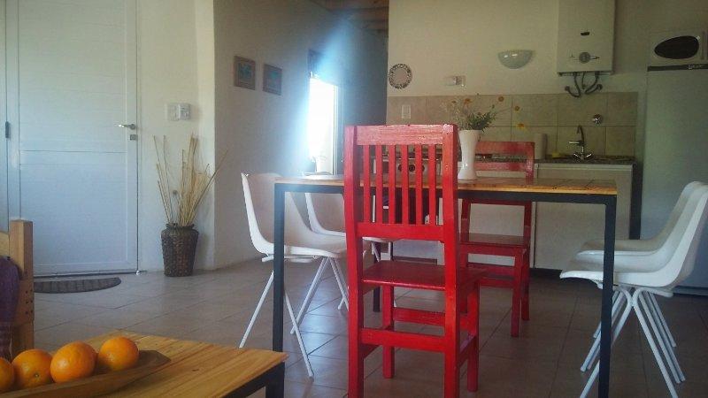 champaqu Dream Villa de las Rosas Traslasierra Córdoba spacious living room w / integrated kitchen