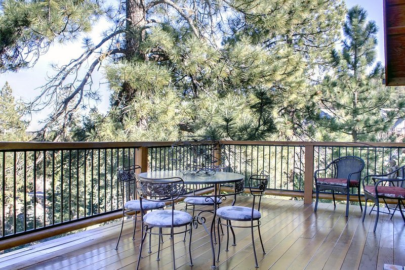 2nd floor large deck with tables & chairs