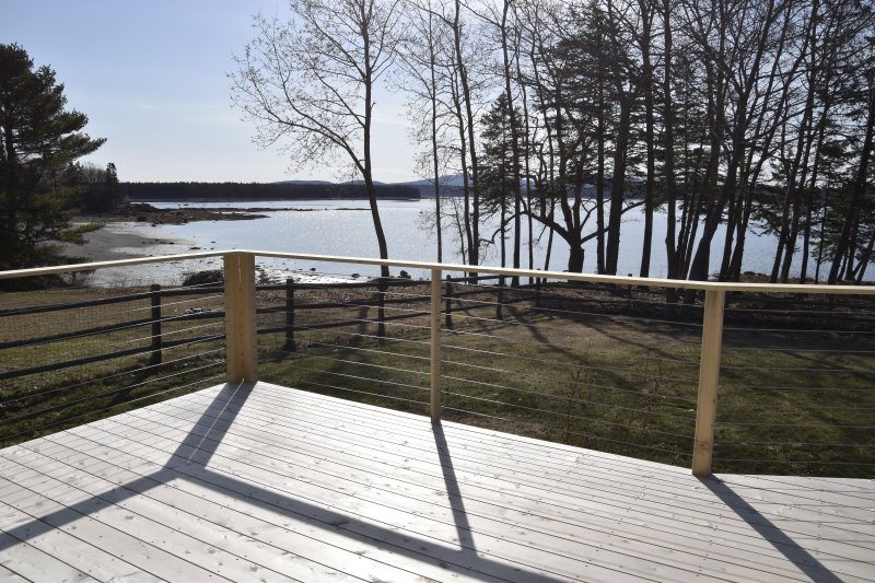 New large cedar deck with a view. Will have dining and conversation seating. And Weber grill.
