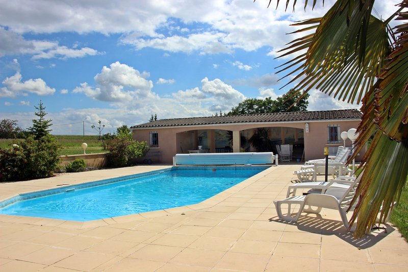 Large 12mx8m swimming pool at local background