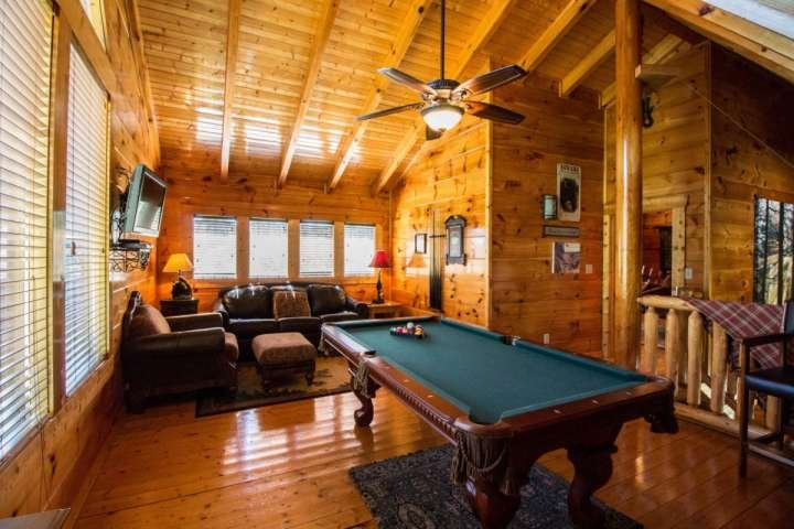 The upstairs loft features extra sleeping with the sleeper sofa, flat screen TV and pool table.