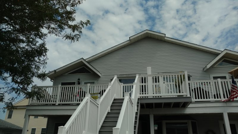 Front stairway leads to large deck & entrance. Driveway parking for 2 cars.