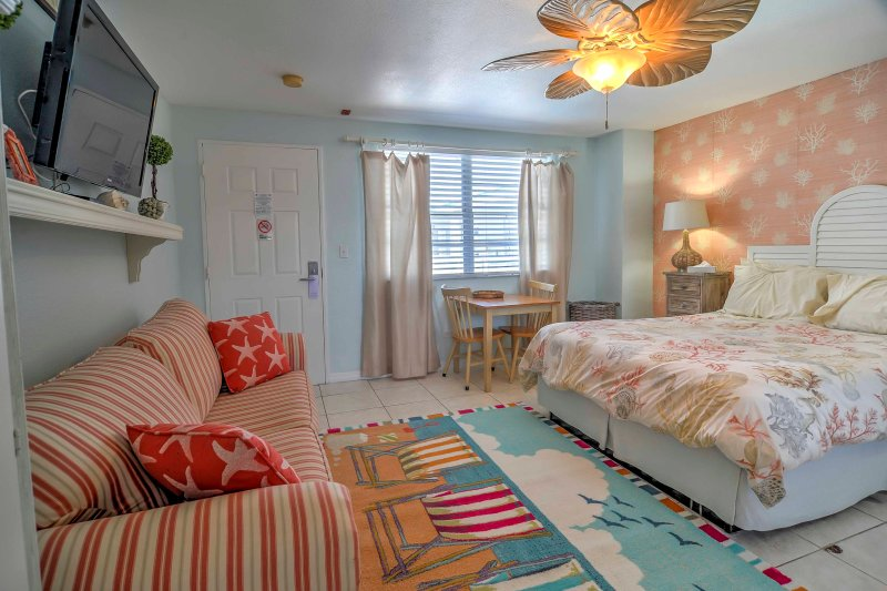 Step inside and feel the Florida charm in this vibrant, uniquely decorated unit.