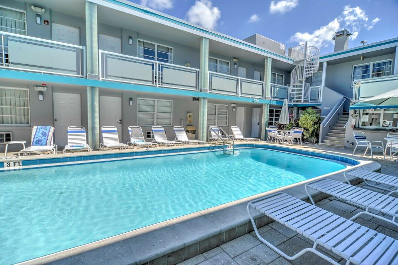 The pool deck showing a spiral staircase leading to the rooftop patio!