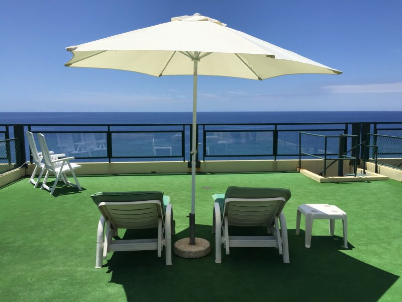 Private rooftop terrace overlooking the ocean