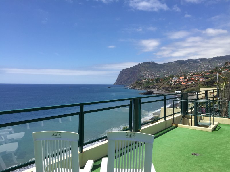 Overlooking the montains and ocean from rooftop terrace