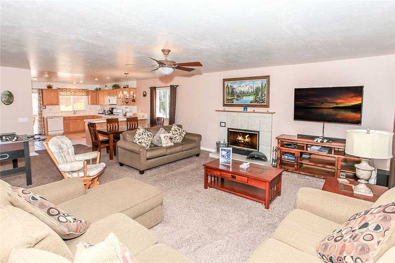 Couch,Furniture,Light Fixture,Entertainment Center,Home Theater