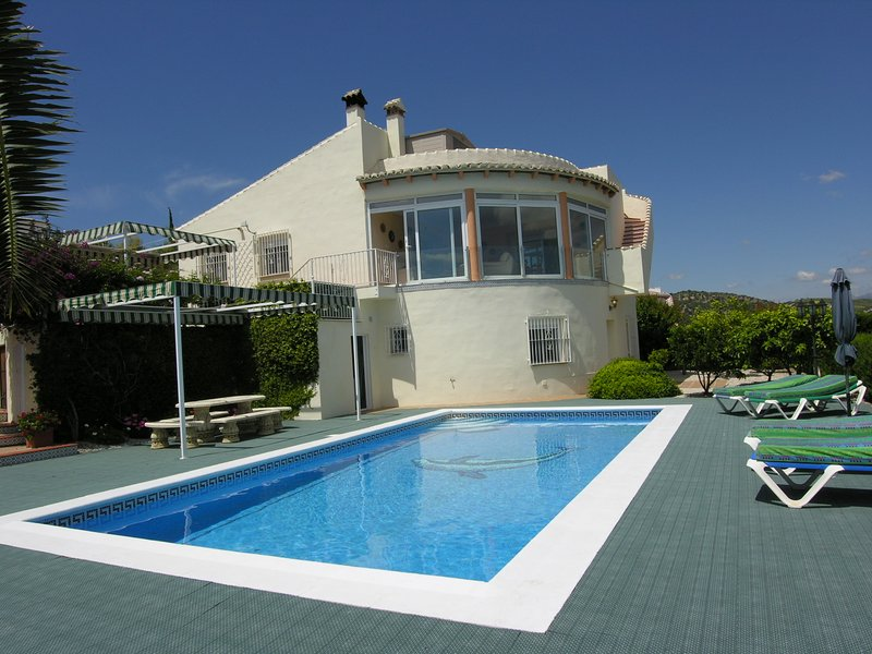Casa Paraíso looking over the large pool area with plenty of space for everyone to relax and enjoy