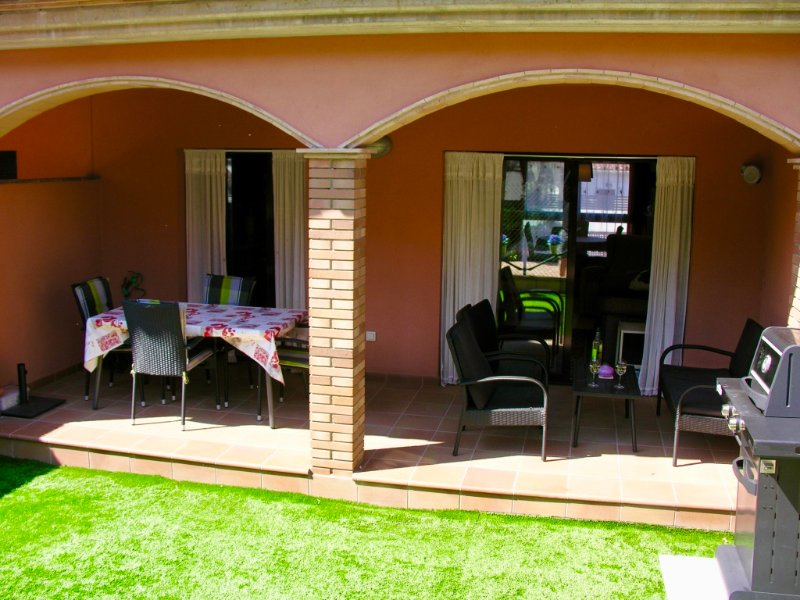 Rear private garden with gas BBQ and covered dining terrace and comfy seating)
