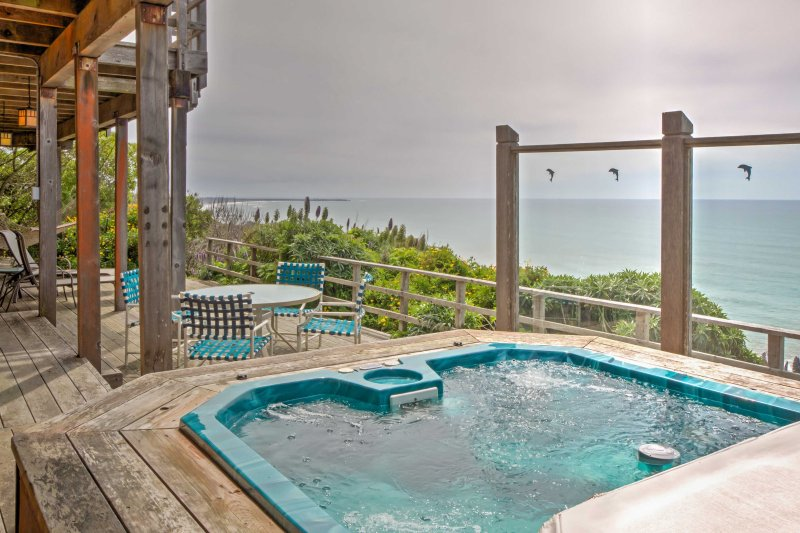Take a soothing soak in the private hot tub.