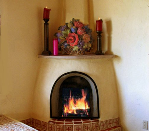 the kiva fireplace in the living room . . . we have radiant heat and a woodstove, too!