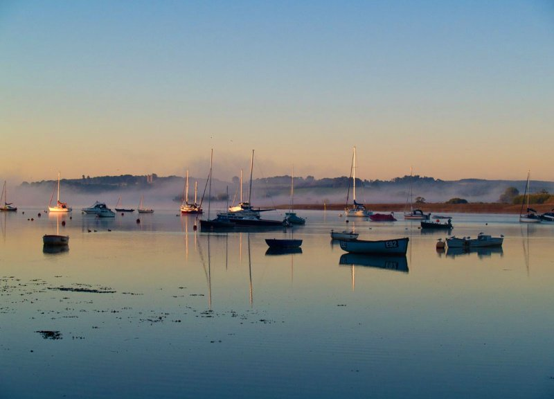 Topsham is on the estuary with great pubs, walks and the cycle trail leading to exeter or emxmouth